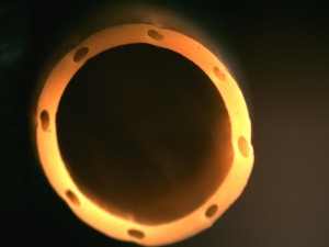 Laser Micro Hole Drilling in multi lumen catheter. Precision Laser Micro Hole Drilling